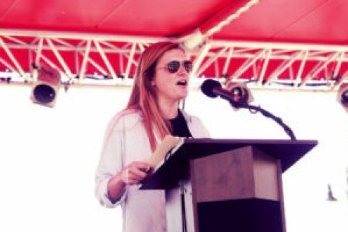 Anais Beddard speaking at farm rally
