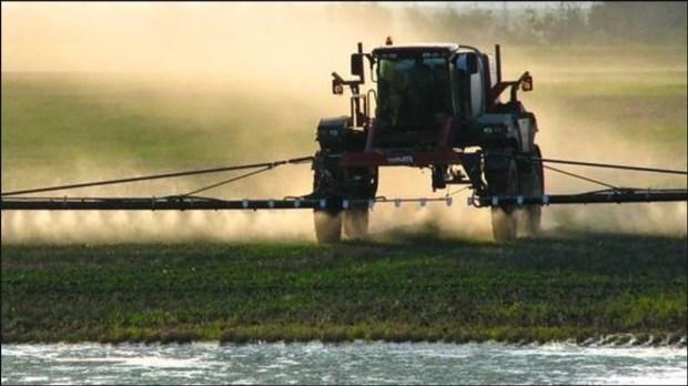 a big tractor rolls through a farm field