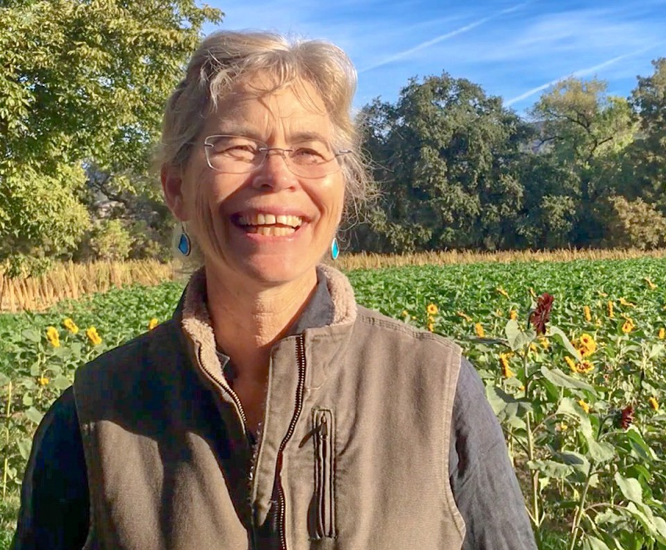 Judith Redmond smiles in front of crops at Full Belly Farm California.