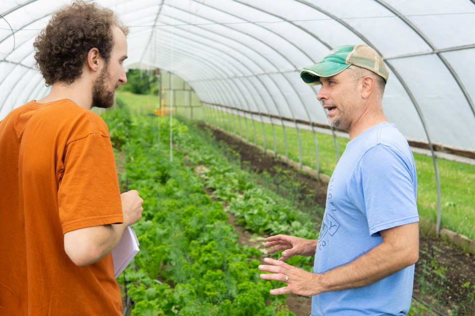 Matt Martin being interviewed in his hoop house at the Martin Family Farm Michigan