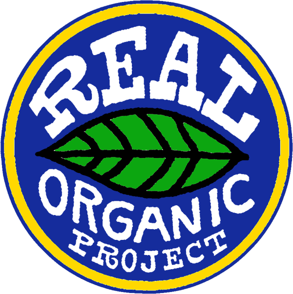"""A blue circle with yellow ring on the edge. Inside the circle are letters reading """"Real Organic Project"""" set above and below a large green and black leaf in the center."""