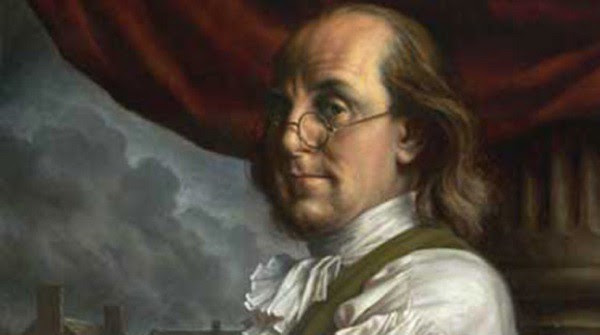 A painted portrait of Benjamin Franklin cropped to show his head and shoulders.