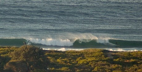 Ice cold wind straight offshore into clean swell.