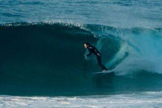 south curl curl beach surfer