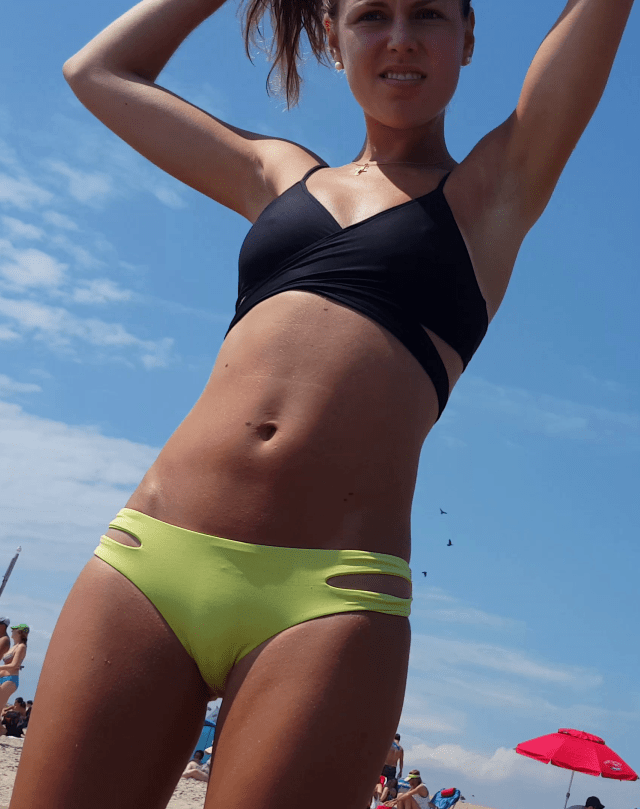 This Cute Amateur Bikini Teen Is Wearing A Sexy Black And Yellow Bikini With Her Nipples Nipping From The Top And Her Pussy Showing A Teasing Cameltoe On
