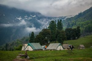 some tents during the day in a valley