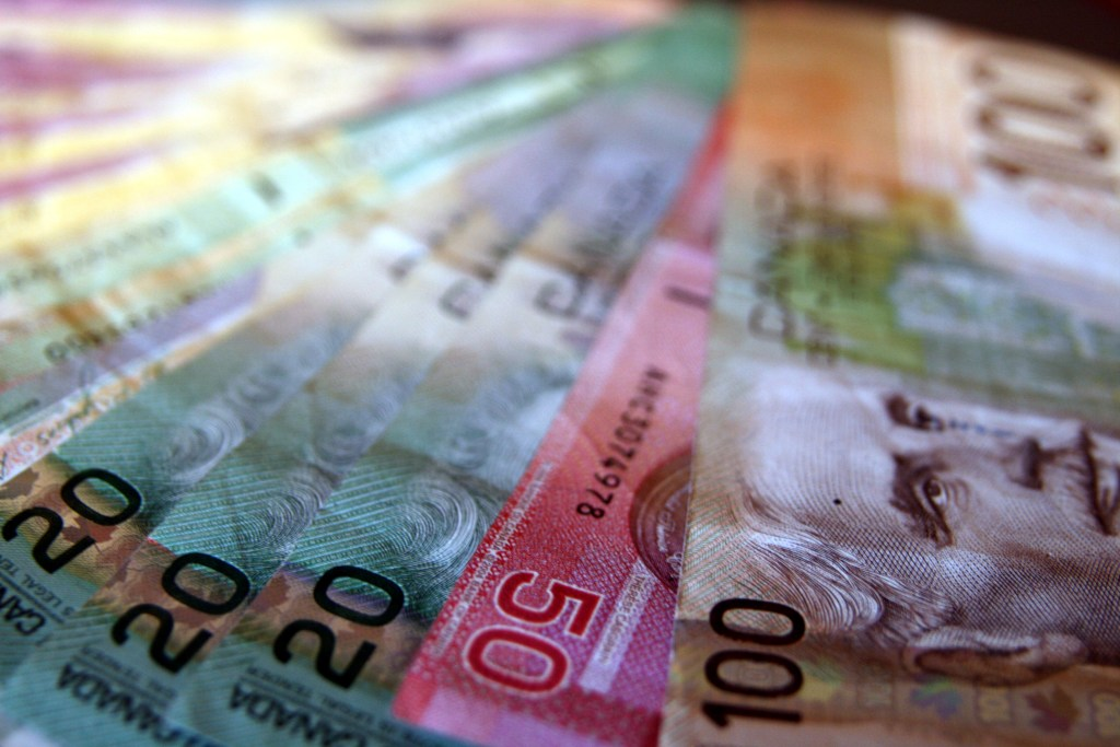 colorful Canadian paper money fanned out including 20, 50 and 100 dollars