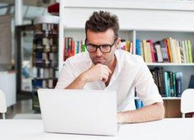 man-reading-laptop