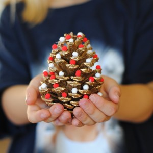 These Pom Pom Pinecone Trees are the perfect Christmas Decoration that the whole family can help make!