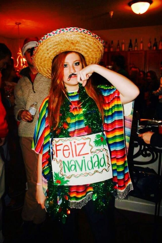 Feliz Navidad Sweater: If you are attending an ugly Christmas sweater party this year, we have got you covered! Here are 25 Ugly Christmas Sweater Ideas for you to use as inspiration.