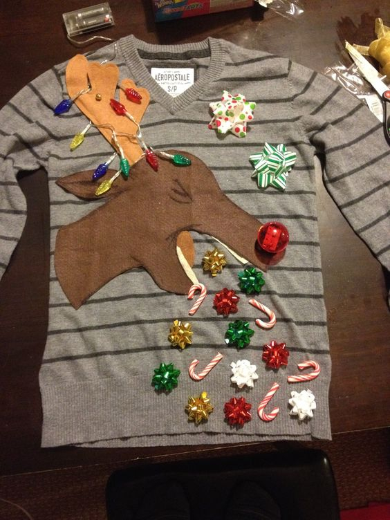 Barfing Reindeer Sweater: If you are attending an ugly Christmas sweater party this year, we have got you covered! Here are 25 Ugly Christmas Sweater Ideas for you to use as inspiration.