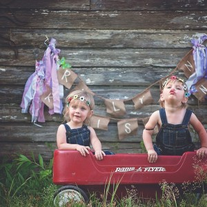 twin girls on a wagon