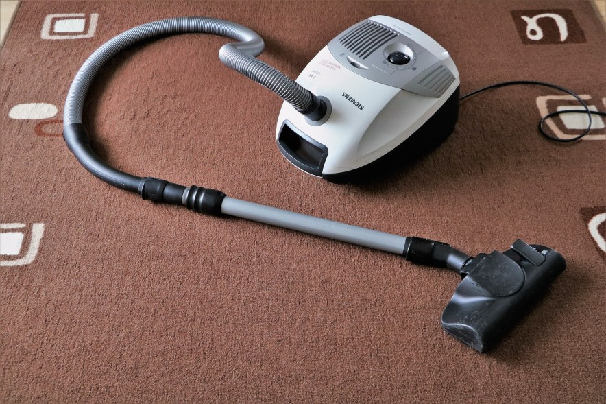 Handheld vacuum in the carpet