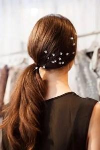 2015 Wedding Trends - Flowers scattered around sleek ponytail, bridal hair from Rebecca Loves Weddings www.rebeccaanderton.co.uk