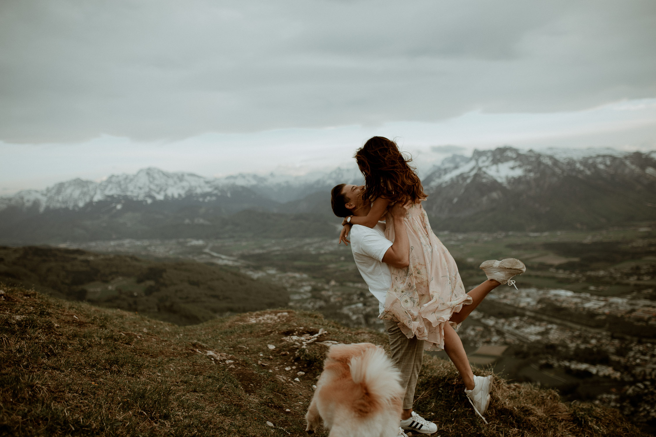 couple on the mountains with dog