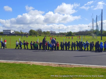 Carrigtwohill BNS snr Infants watching the games