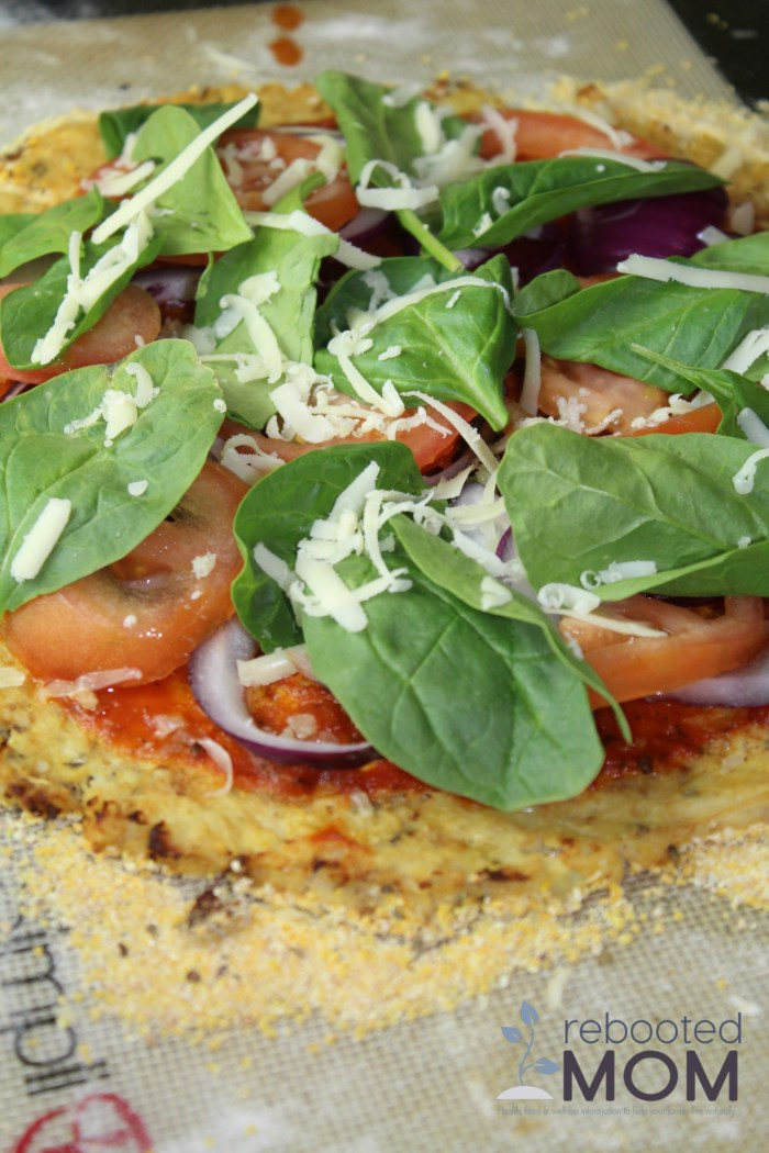 A simple cauliflower pizza crust that contains simple ingredients and easy-to-follow instructions. The finished crust is crispy on the outside and flavorful on the inside.