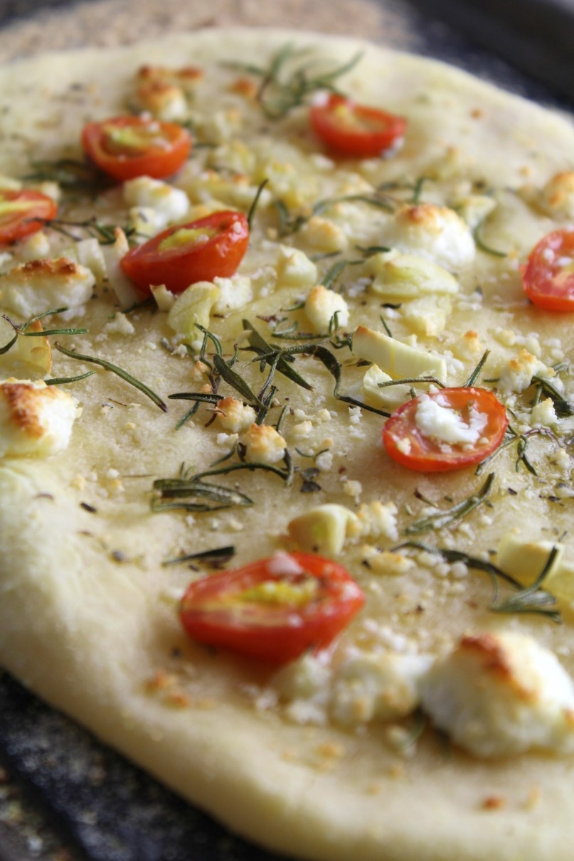 A delicious grain free, gluten free Rosemary Garlic Tomato Flatbread drizzled with a little fresh olive oil and topped with fresh cheese.