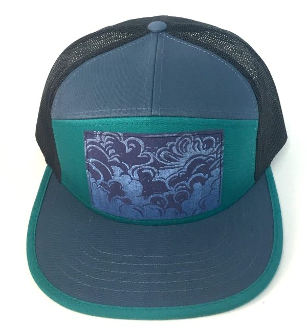 Front view of Ocean Blue and Teal 7 Panel with Head in the Clouds print hat
