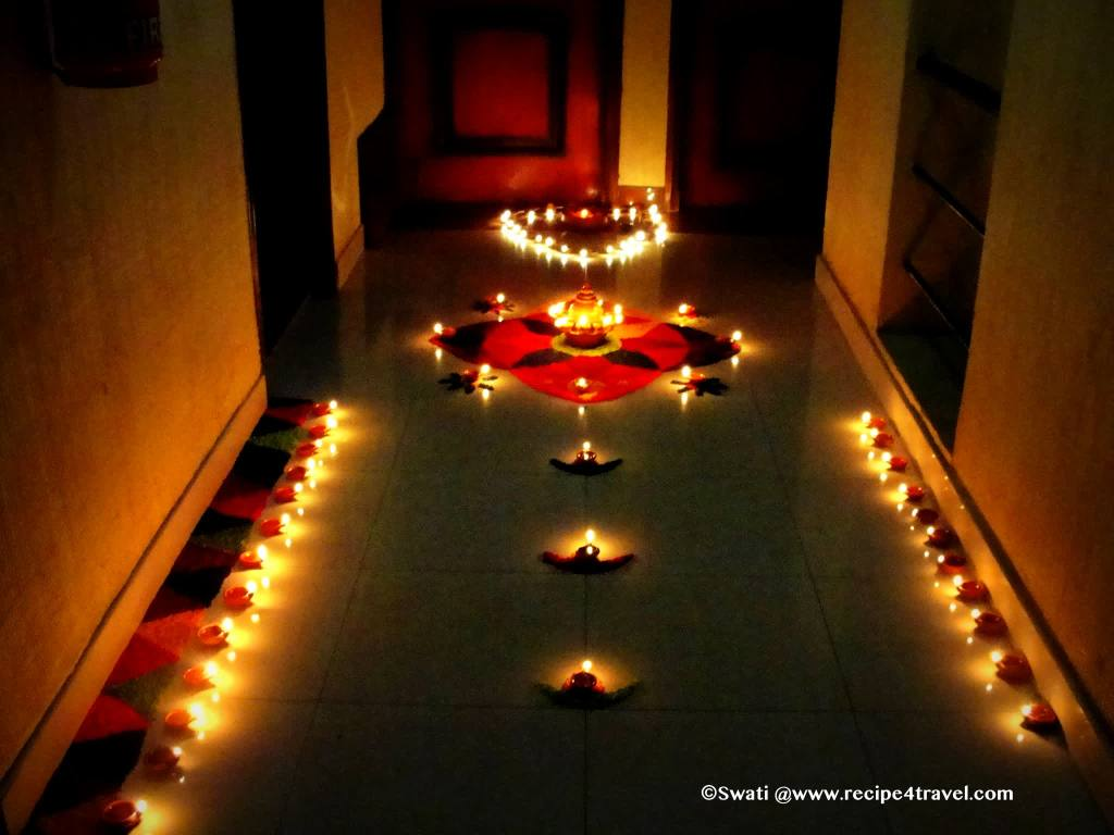 Diyas (lamps) lit up in front of the house