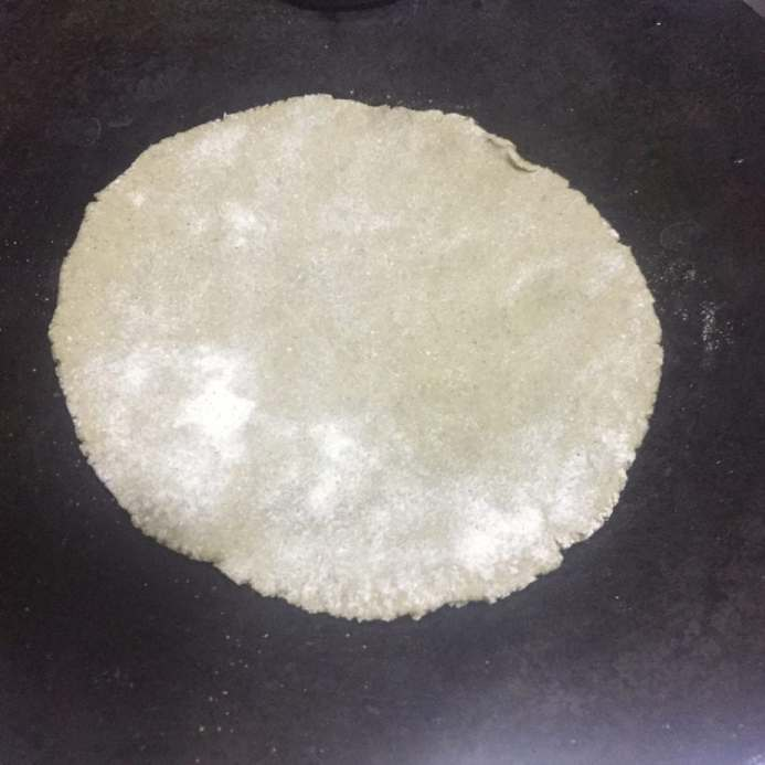 Cook roti on hot griddle.