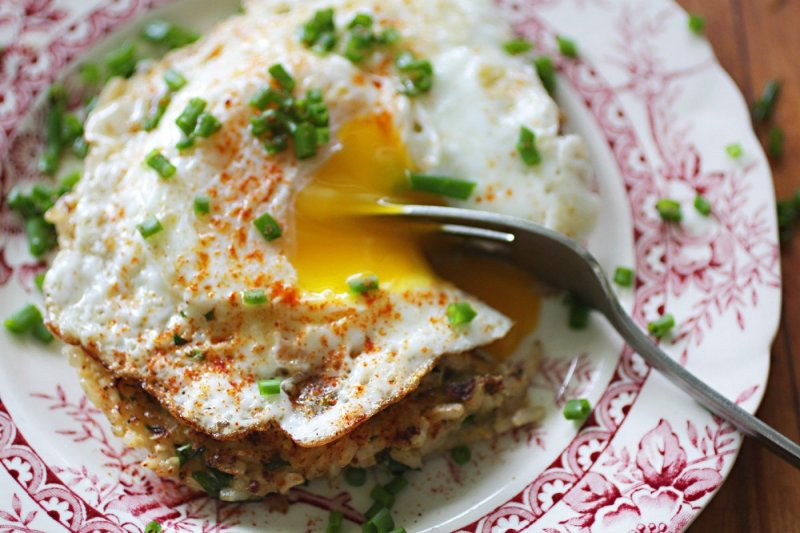 Lemon Quinoa-Rice Patties topped with a Fried Egg