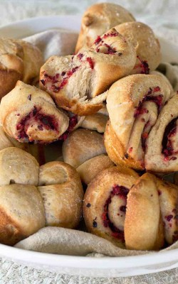 tender whole wheat cloverleaf dinner rolls and cranberry swirls