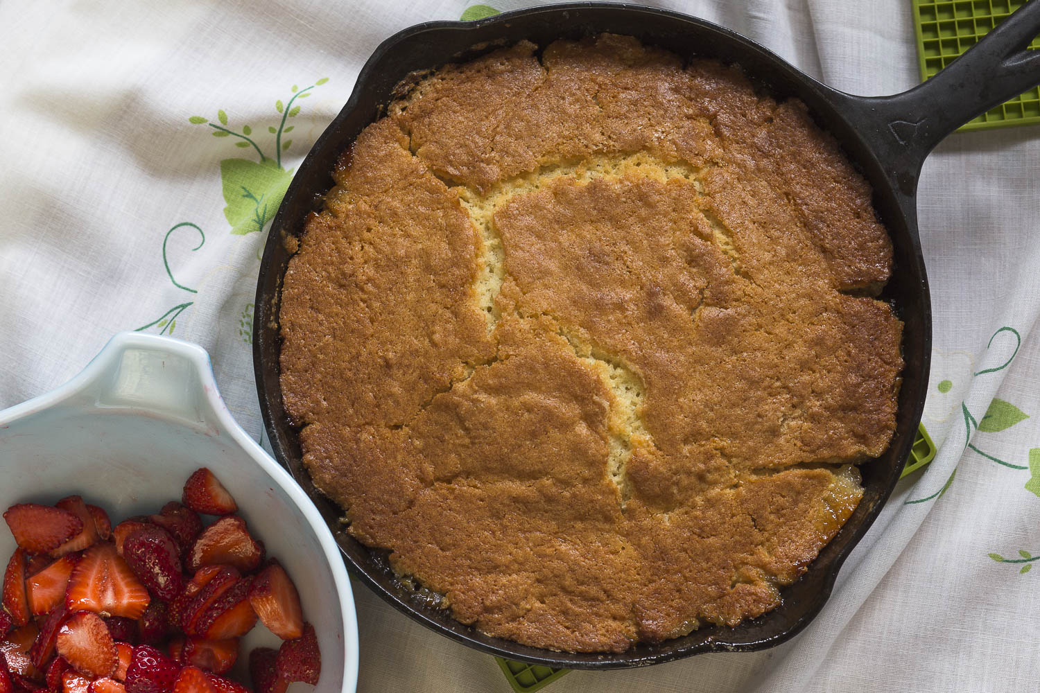 Cast Iron Rhubarb Upside Down Cake with fresh strawberries