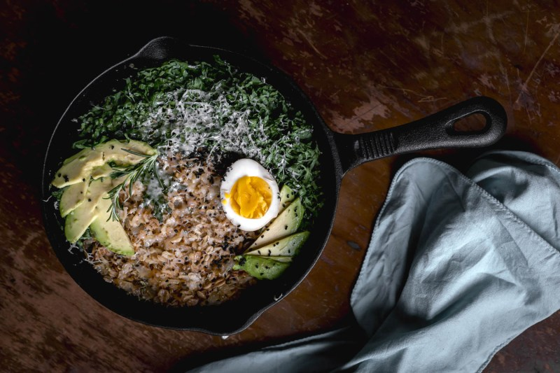 Savory Cast Iron Oatmeal with pickled egg, avocado, and kale