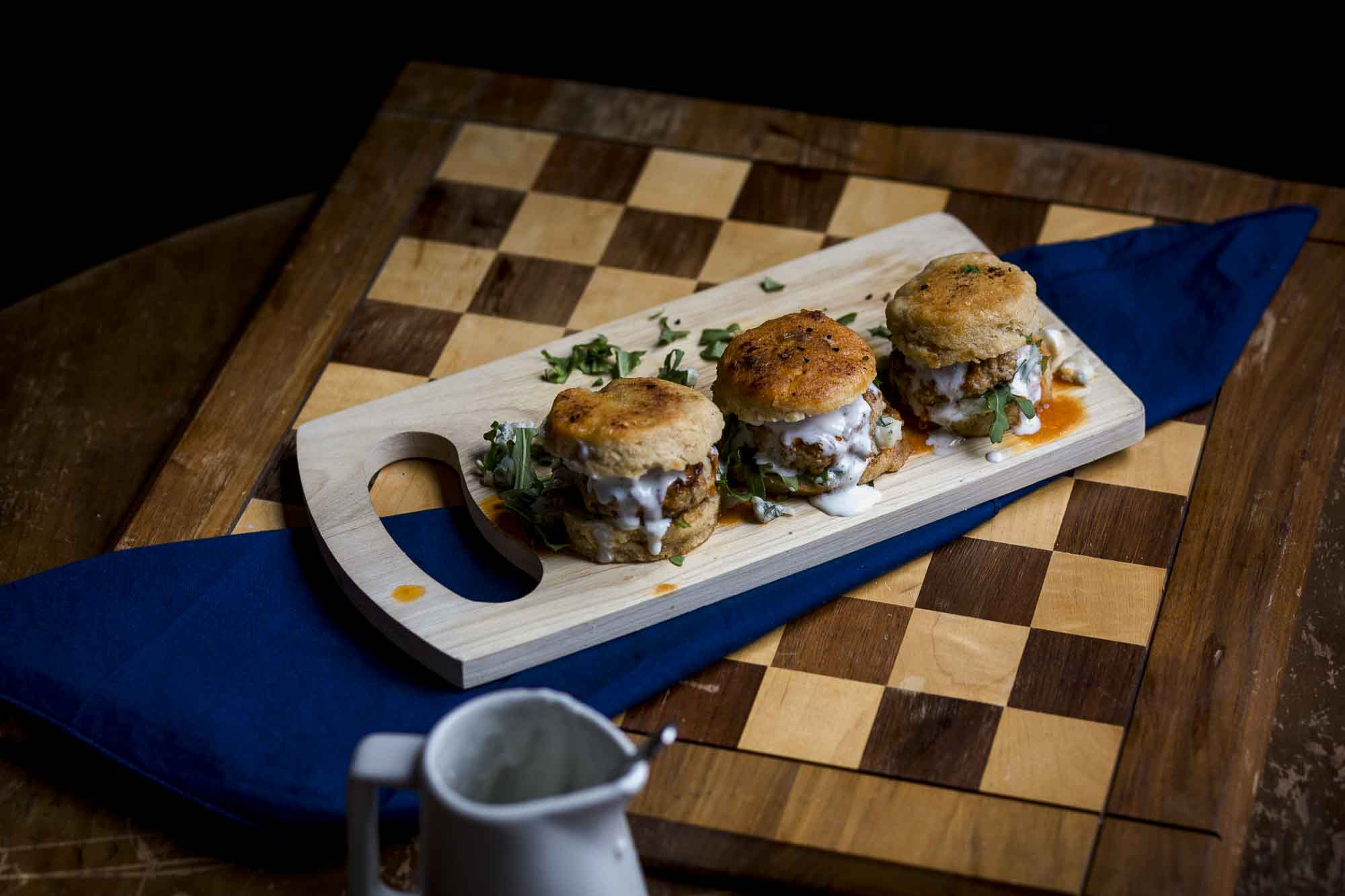 Buffalo Biscuit Sliders with buttermilk blue cheese sauce