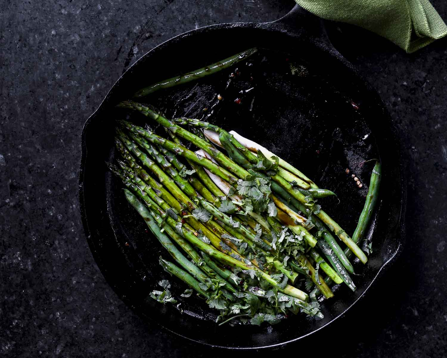 asparagus, green beans, and scallions tossed with egg roll sauce in cast iron pan
