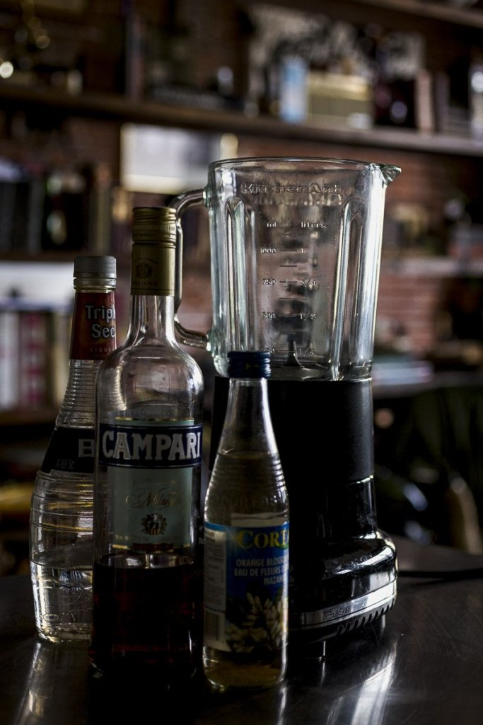 Ingredients and blender for Campari Orange Slushies with triple sec and orange blossom water