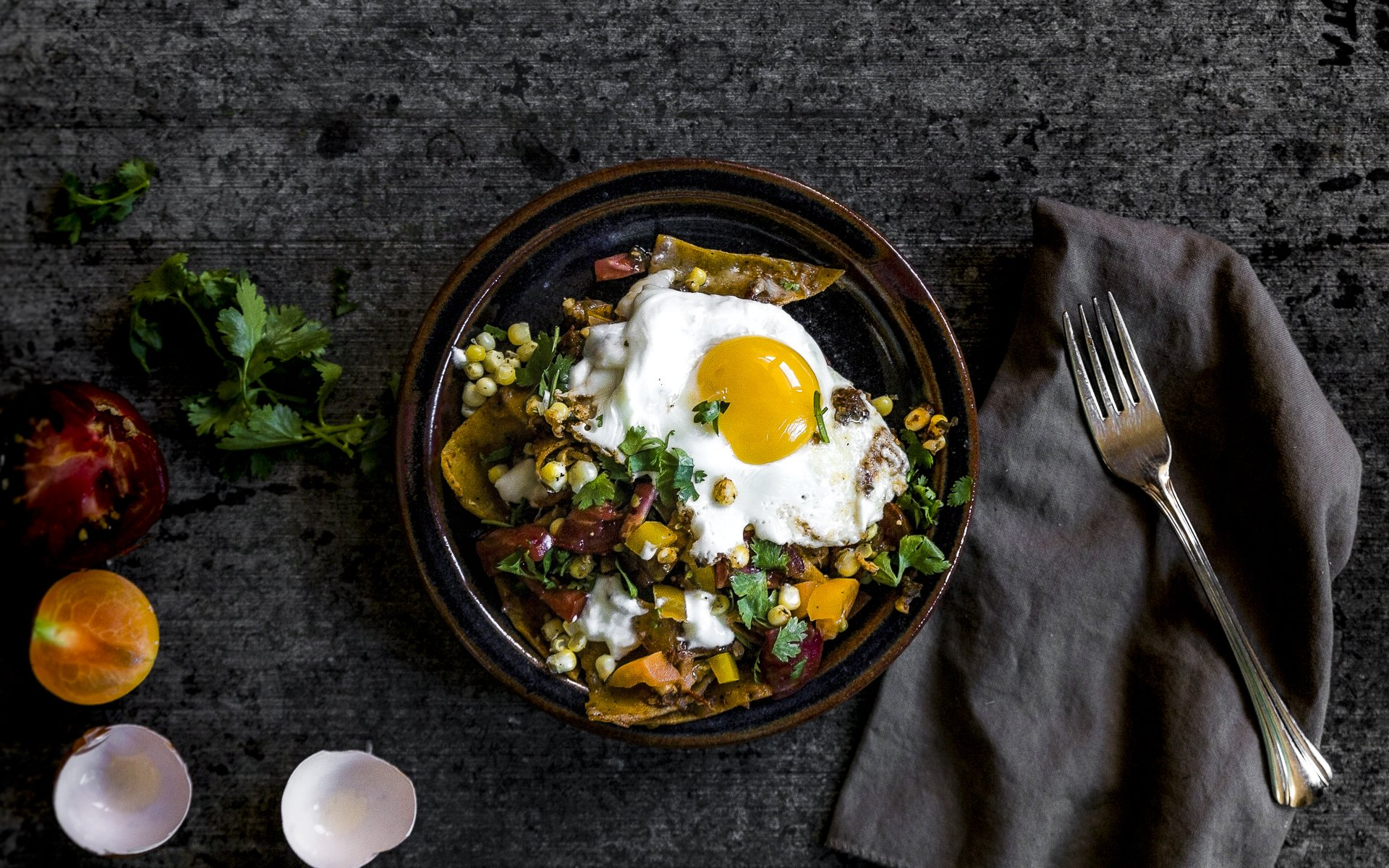 wide shot of Summertime Chilaquiles recipe with fresh tomatoes