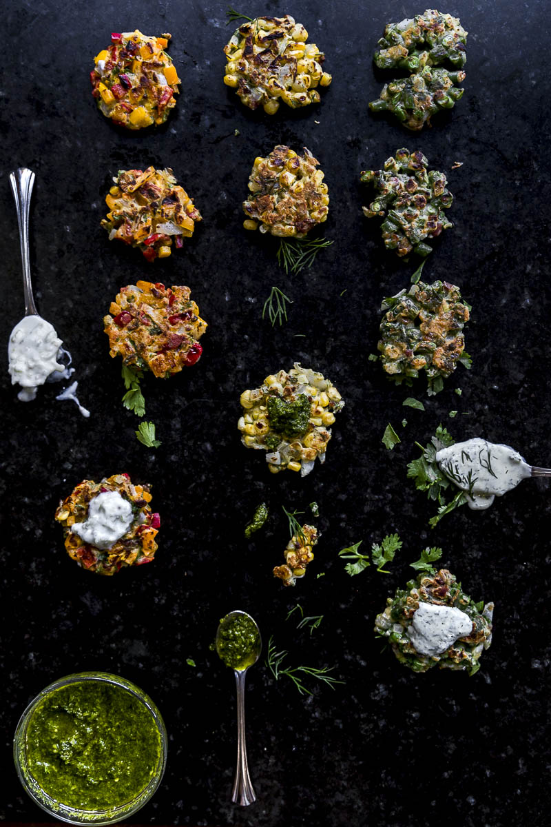 flatlay of Small batch summer vegetable fritters with dipping sauces