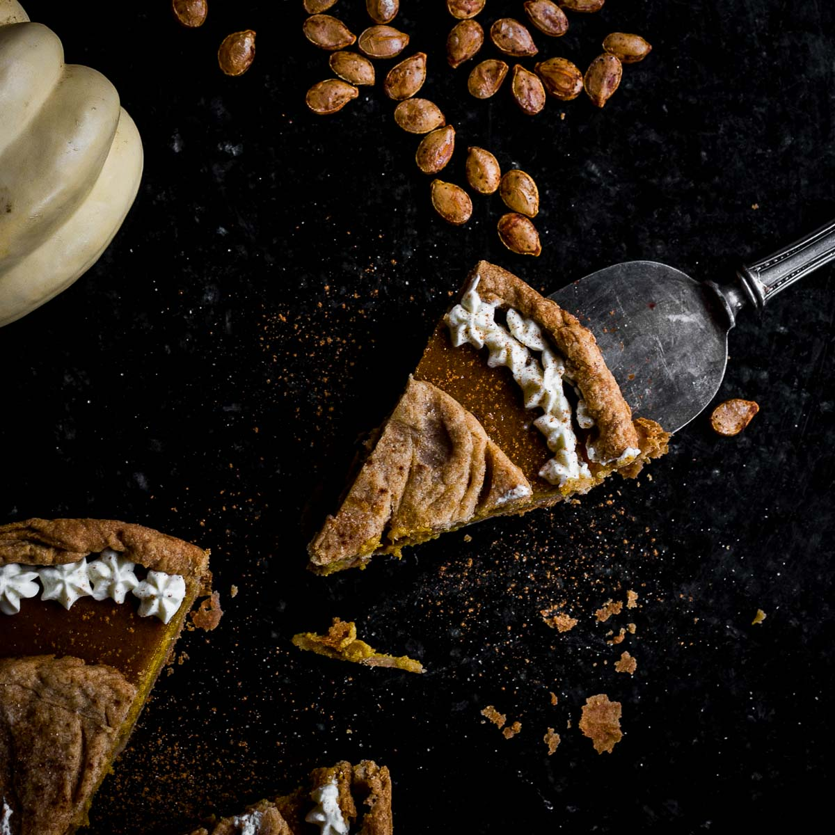 slice of cast iron winter squash pie with whipped cream
