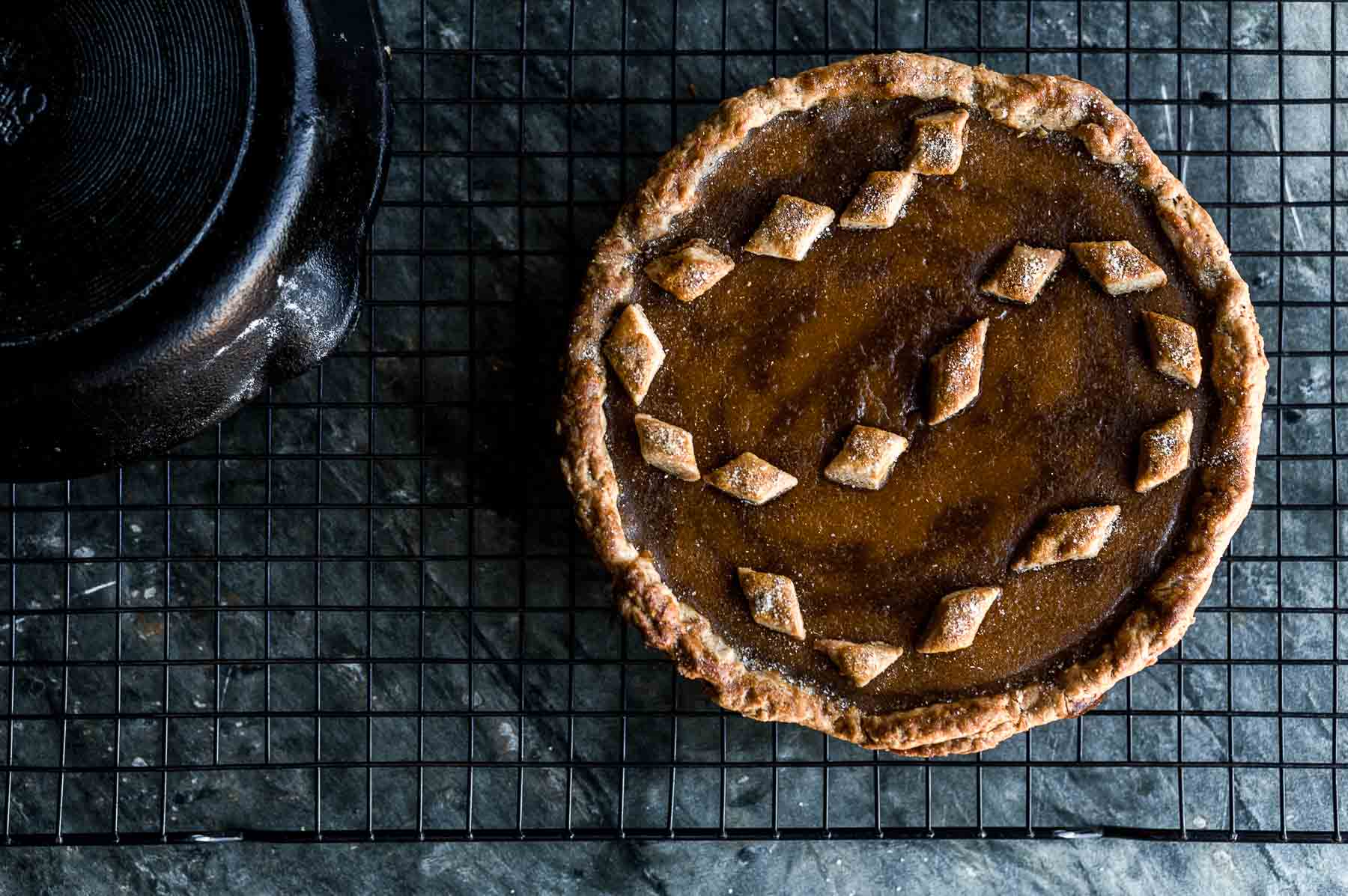 cast iron winter squash pie removed from cast iron and cooling