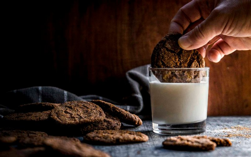 spicy gingersnap cookies dunked in milk