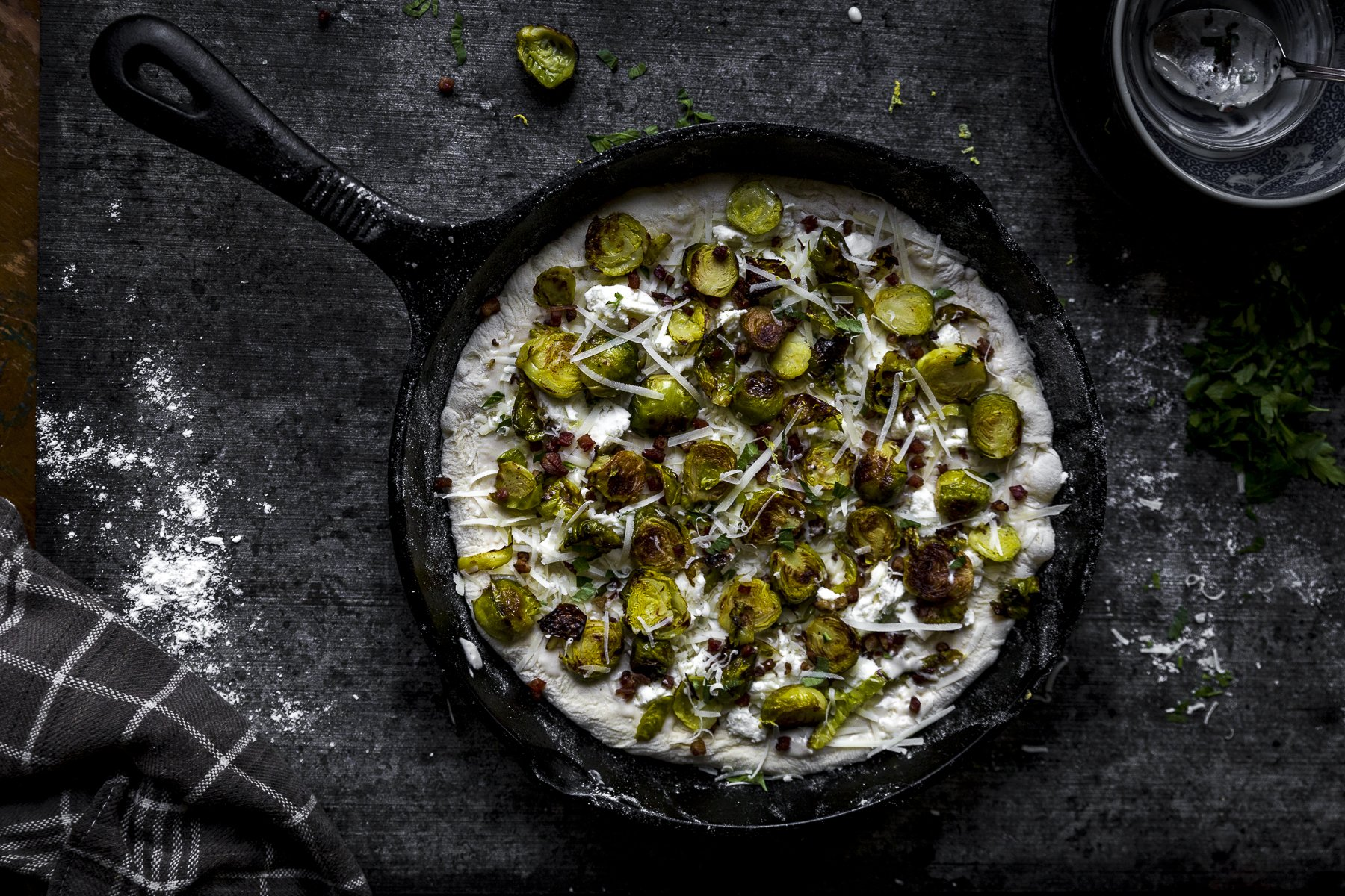 roasted brussel spouts on pizza in a cast iron skillet