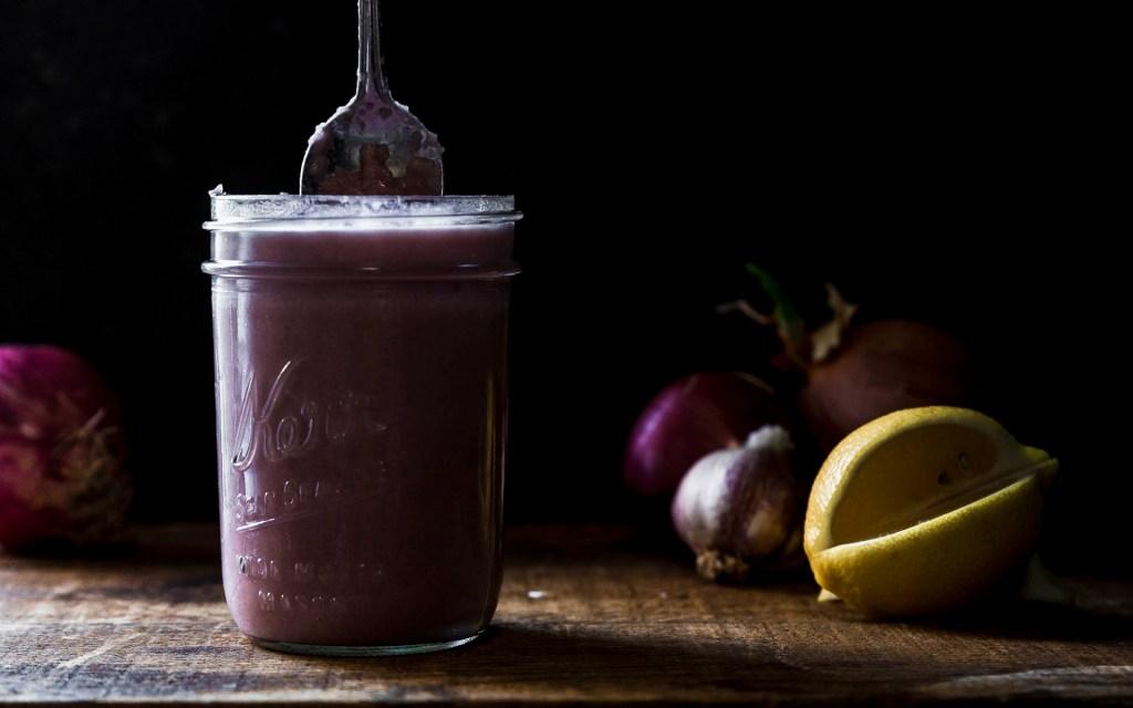 a giant jar of Roasted Onion Cream- simple, vegan, onion sauce