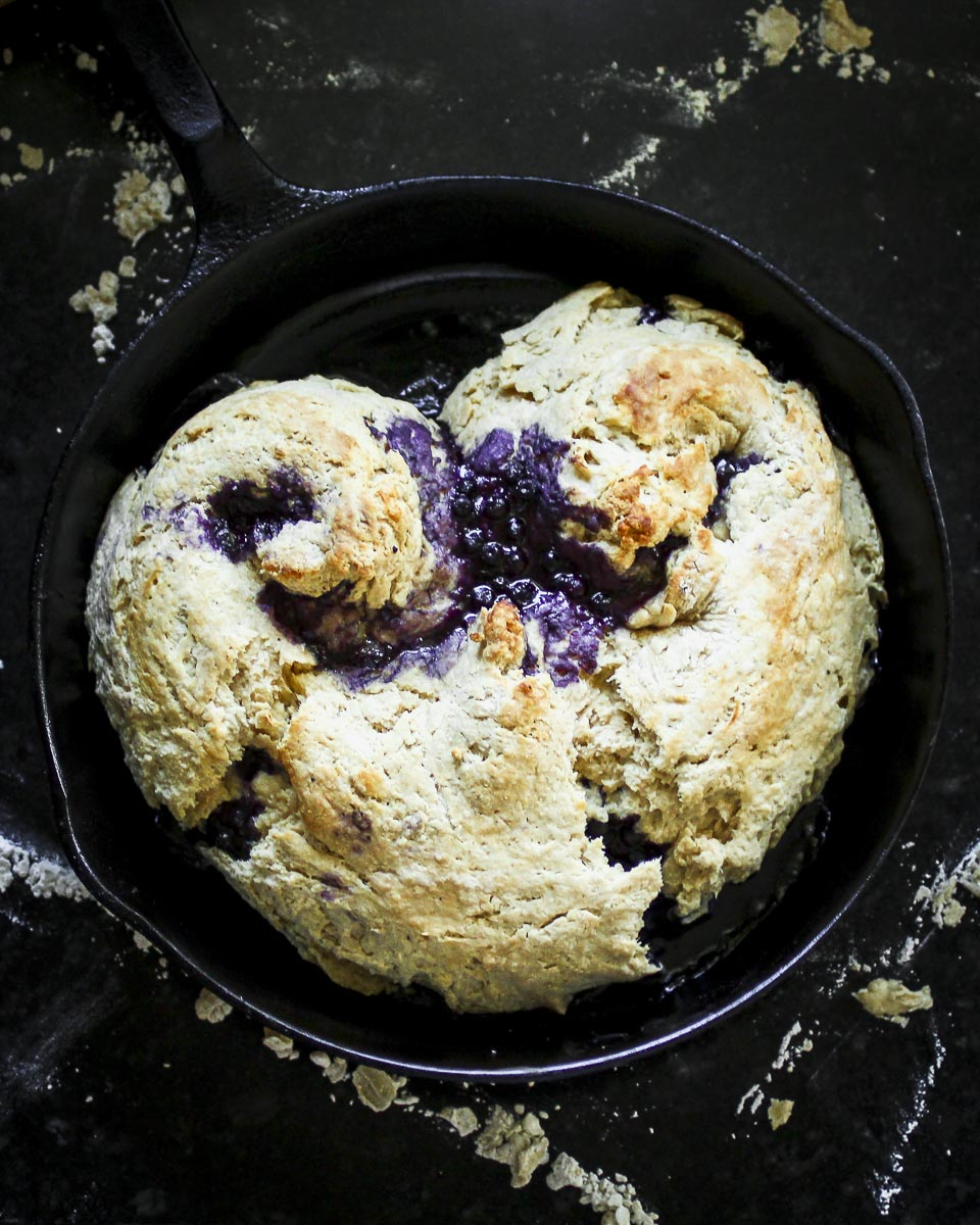 a big blueberry biscuit heart baked in a cast iron skillet