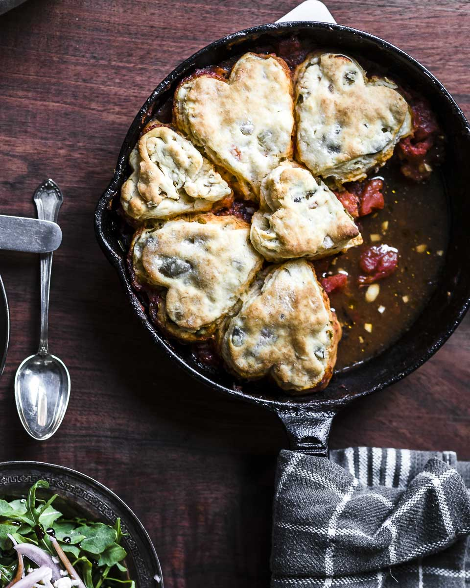 overhead shot of Bloody Mary Chicken Pot Pie with Olive Biscuit Crust