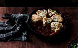 Bloody Mary Chicken Pot Pie with Olive Biscuit Crust served ina cast iron skillet