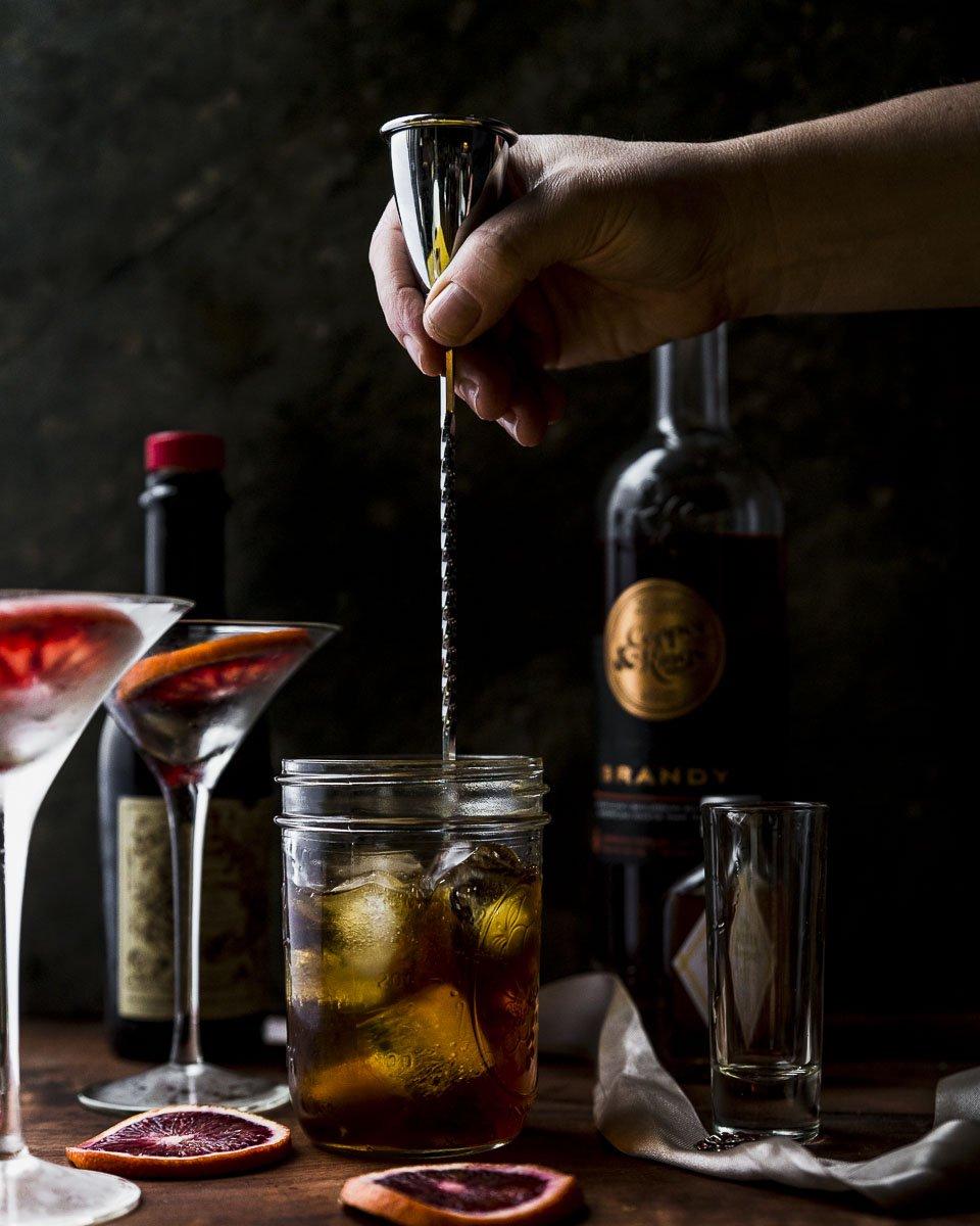 stirring the brandy manhattan