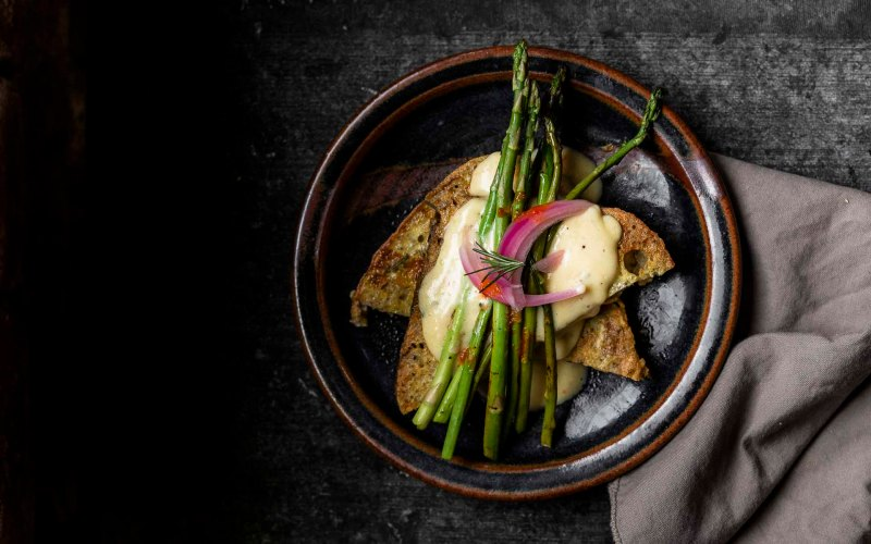 Overhead shot of Savory French Toast with Hollandaise for One with asparagus and pickled onion