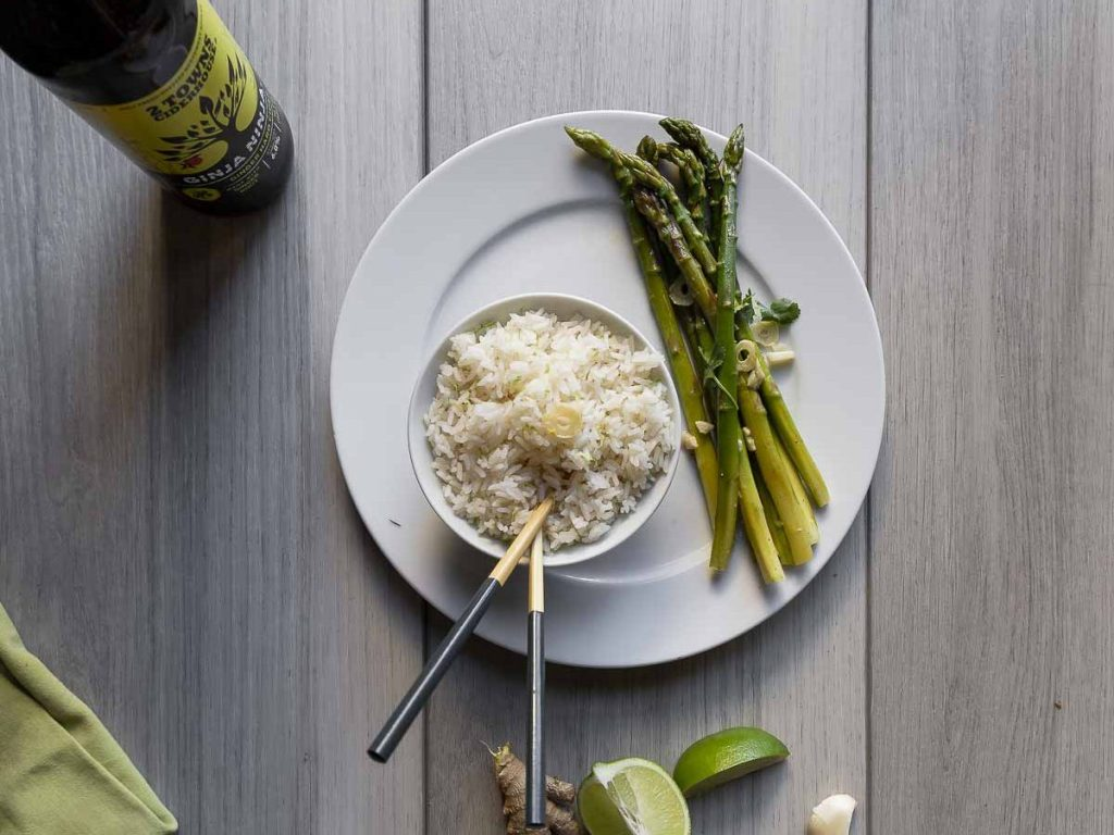 overhead shot of a serving for two of ginger rice and asparagus