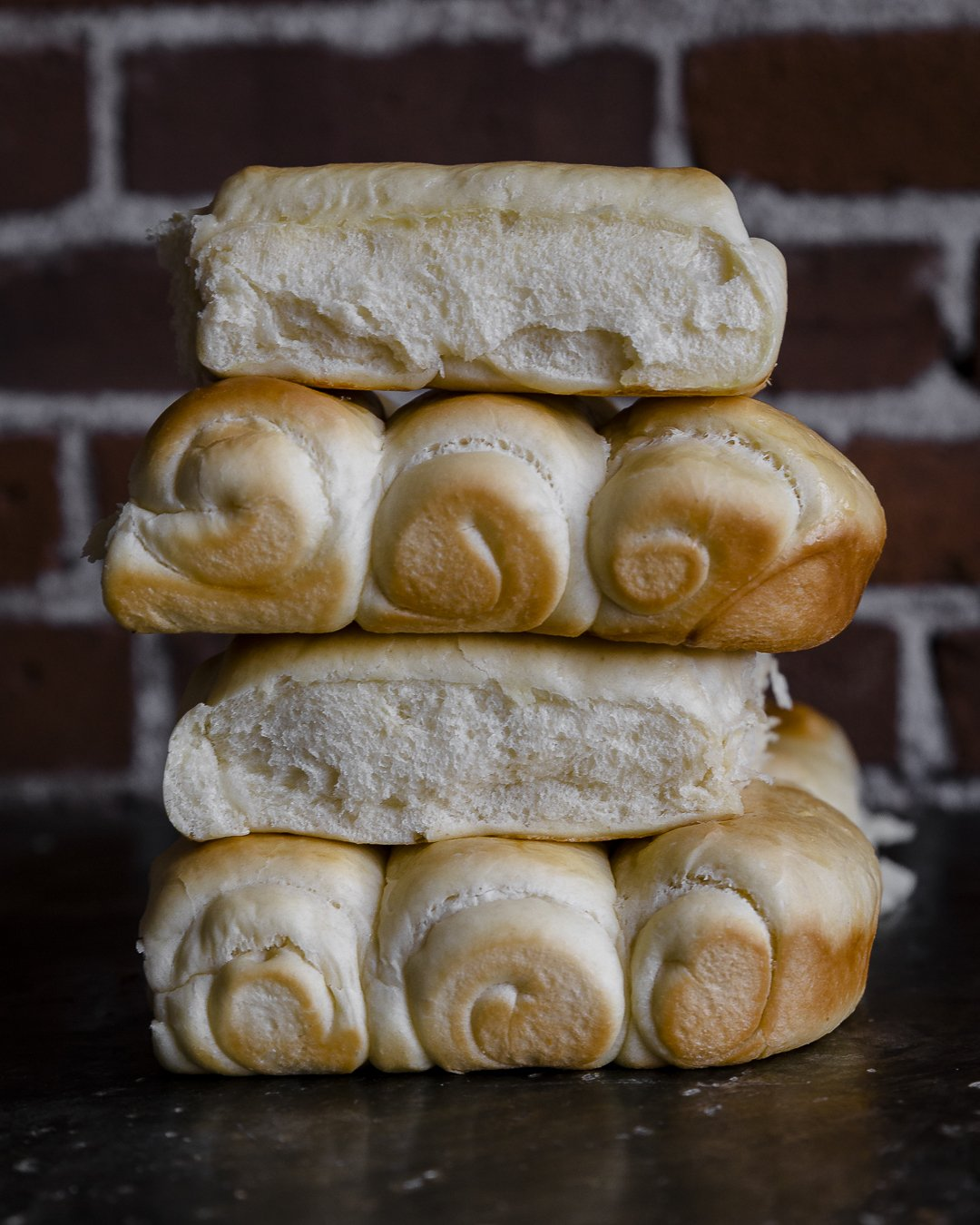 a stack of homemade hot dog buns, showing the ideal color and texture