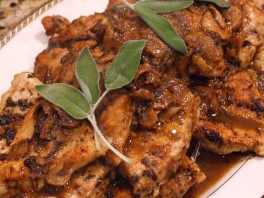 Chicken Marsala garnished with fresh sage