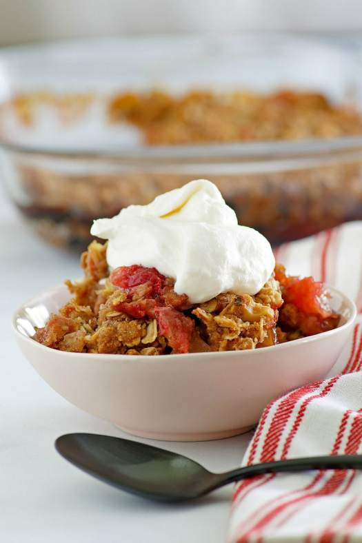 Bowl of Apple Cranberry Crisp topped with Maple Whipped Cream