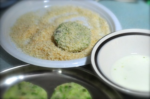 aloo tikki burger - dip in bread crumbs