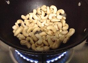 add raw cashews to pan
